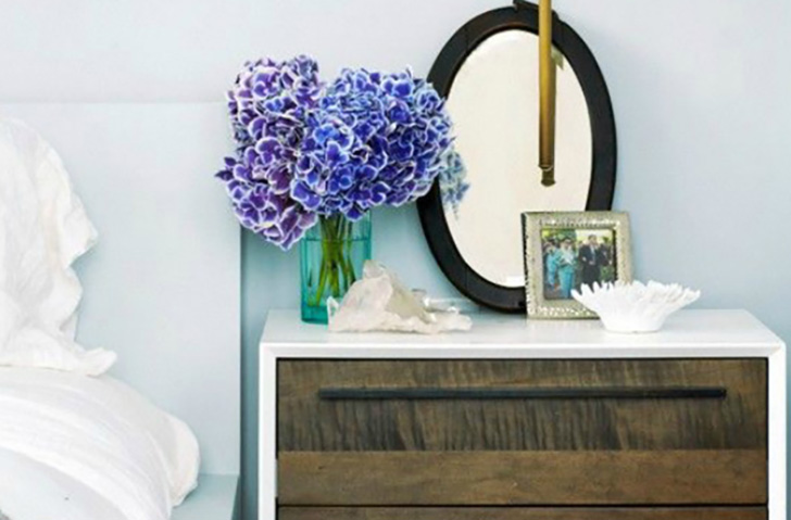 Night stand with mirror and flowers