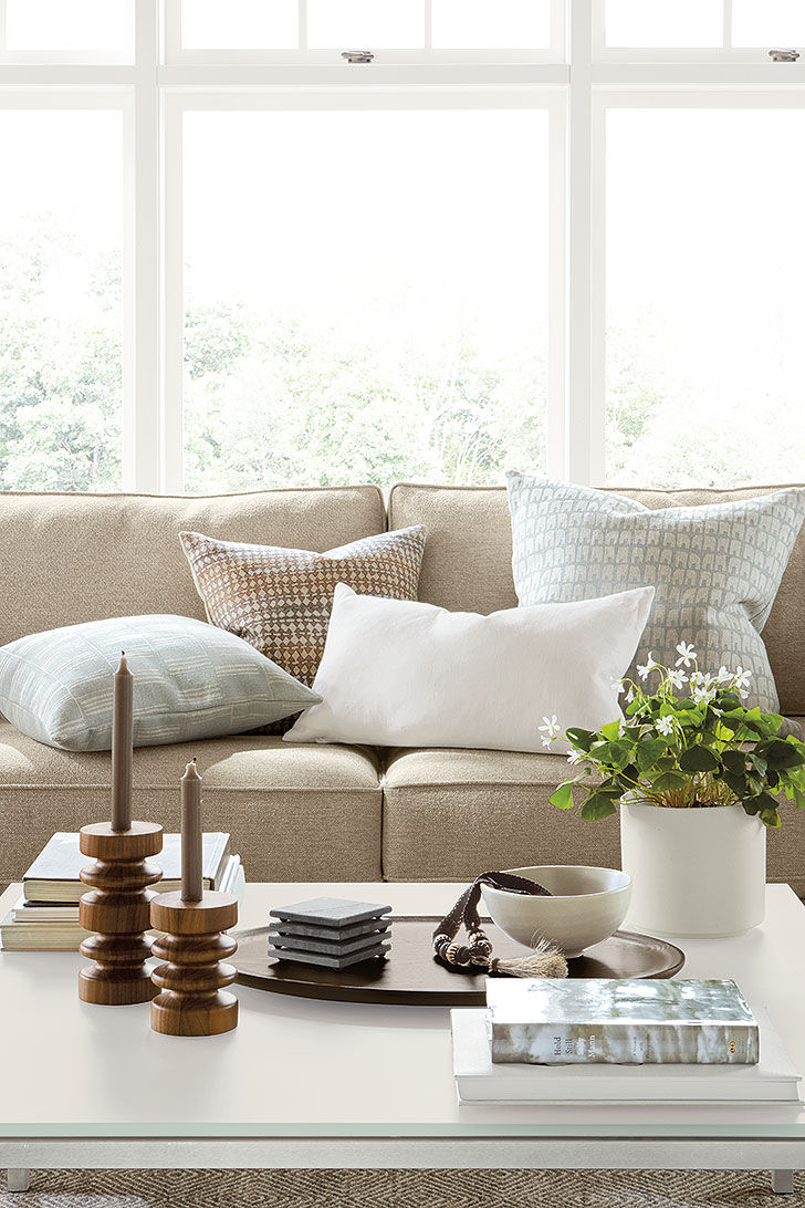 Row pillows with Astor candle holders