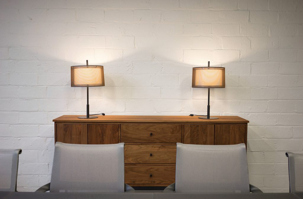 Linear storage piece and Echo Table lamps