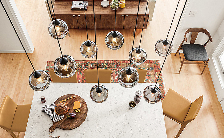 Banded pendants by Hennepin Made in dining room