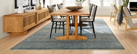Hart wood dining table with Sivas blue rug for open concept space