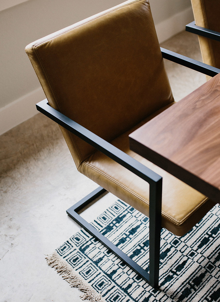 Dining space with Corbett table, Lira chairs, Tulum rug