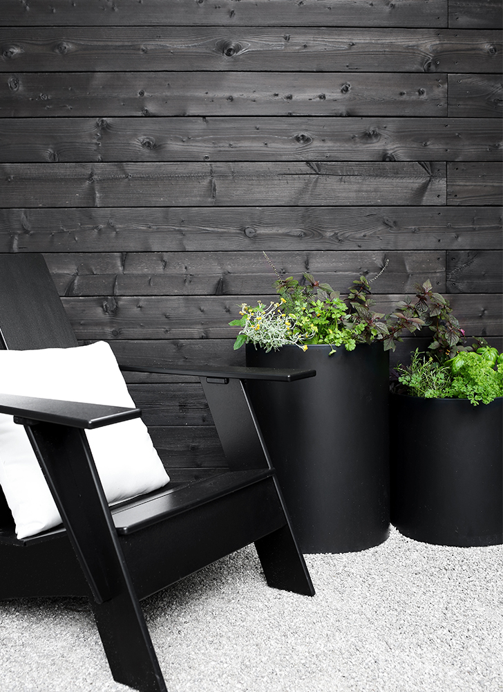 Close up of planters in backyard makeover