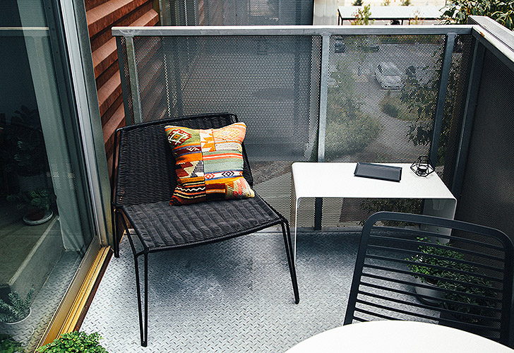 Penelope chair and Cooper bench on small space balcony