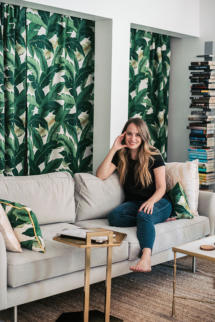 Grace Atwood lounging on her living room sofa