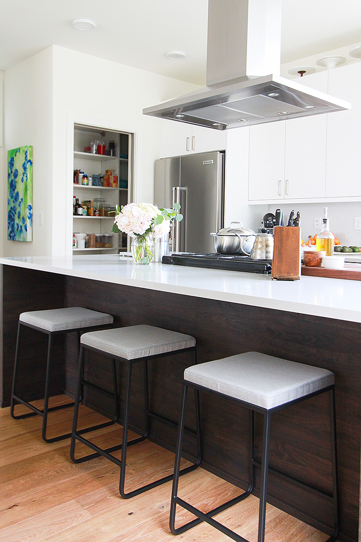Kitchen counter with modern bar stools
