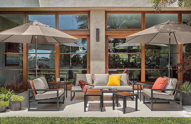 Outdoor lounge space with sofas and chairs