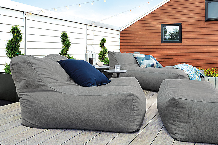 Modern outdoor bean bag chairs with blue pillows