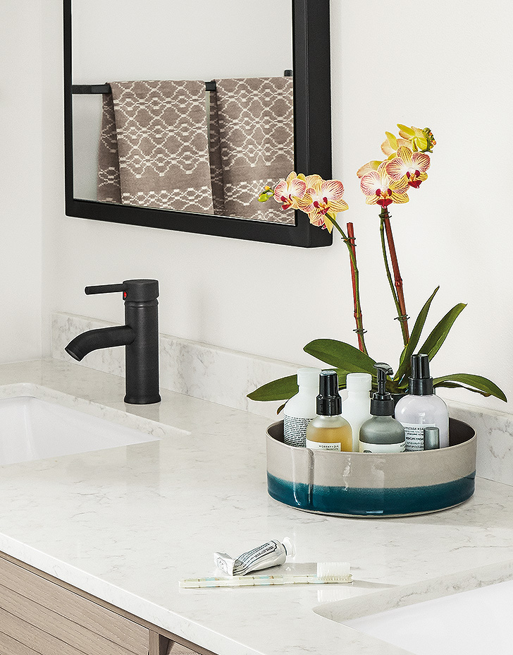 Handmade Cumberland ceramic tray organizes a modern bathroom.