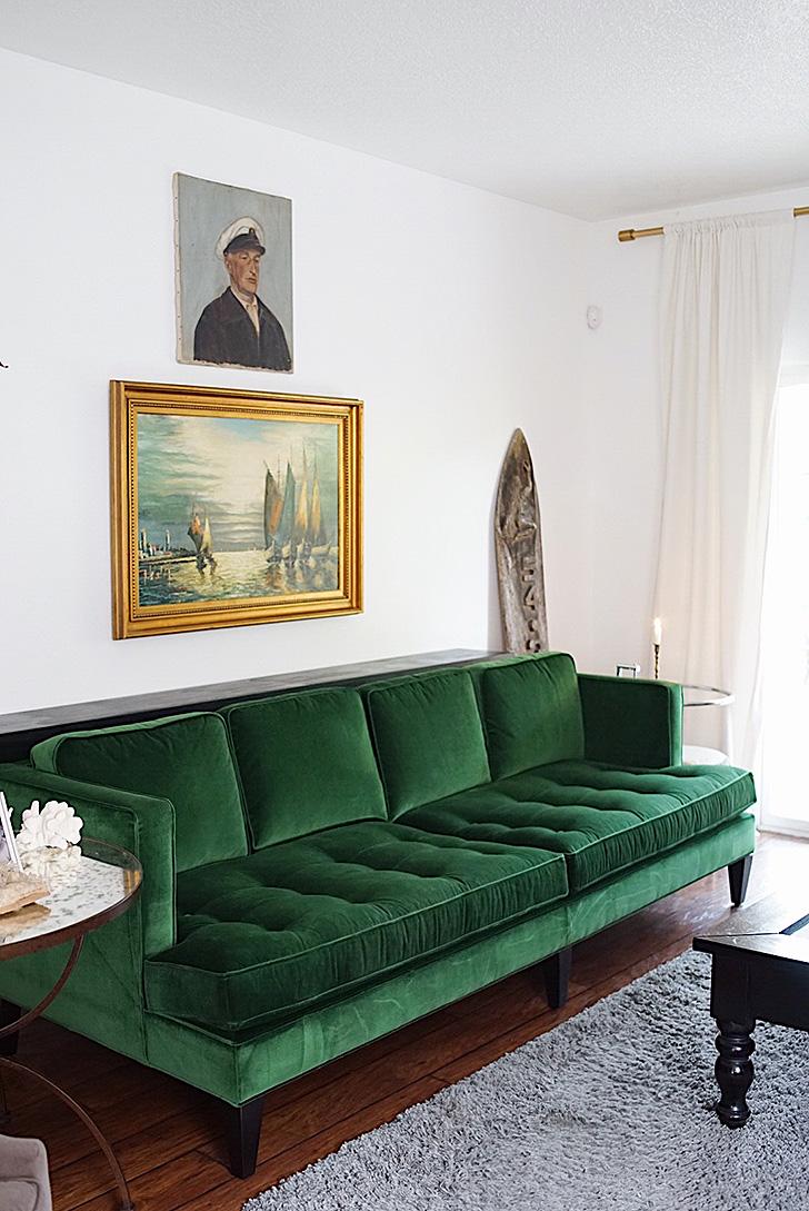 Green velvet sofa in living room