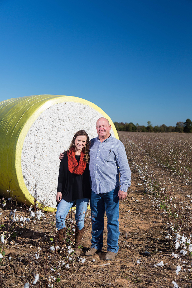 Mark Yeager and Anna Brakefield shown by a cotton bale that will become American-made bedding